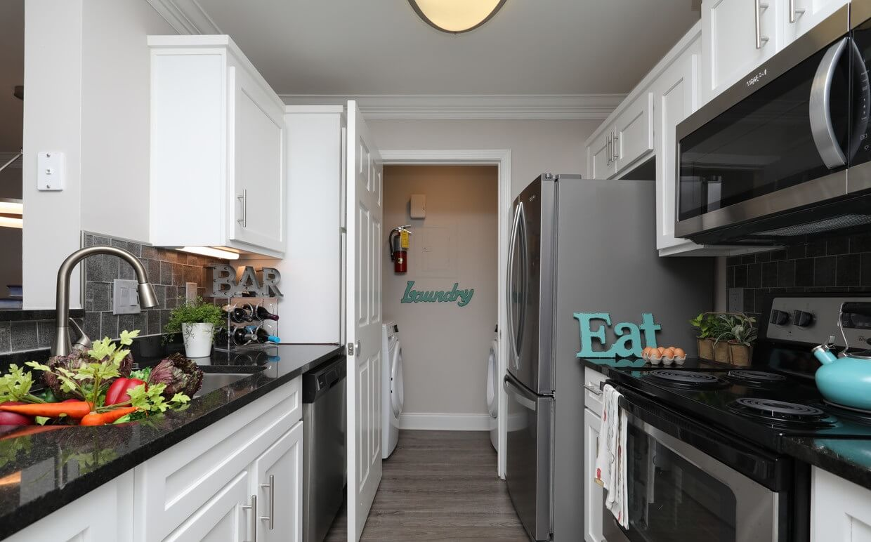Arbor Gates at Buckhead kitchen with white cabinets and stainless steel appliances.
